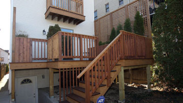 Full view of deck with planters and balcony