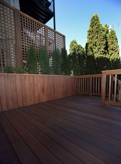 Deck and long planter with lattice work in West Town neighborhood, Chicago.