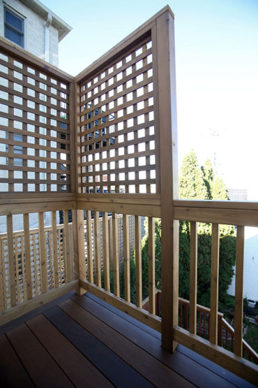 Railing and lattice work on balcony in West Town.